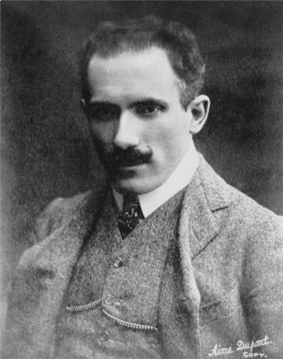 head and shoulder shot of youngish man with dark hair and moustache