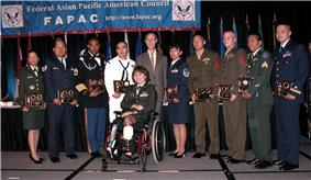 Nine servicemembers representing the four active duty services, reserve components and the Coast Guard were presented the Federal Asian Pacific American Council's Military Meritorious Service Award during the Defense Department's Asian Pacific American Heritage Month luncheon and military awards ceremony in Arlington, Va., 2 June.