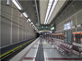 Subway-station platform, with train on one side