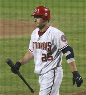 Austin Kearns, playing for the Washington Nationals, holding a baseball bat.