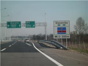 Directional traffic signs placed on a gantry and next to the A3 motorway