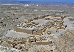 Ruins of buildings in a desert.