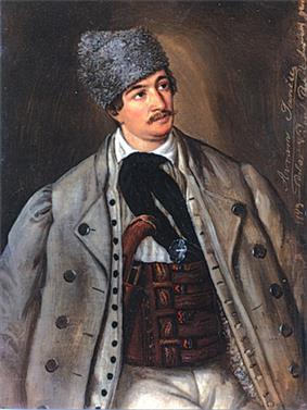 Mustachioed man in greatcoat and large hat