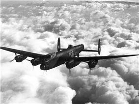 An inflight image of a four-engined bomber aircraft