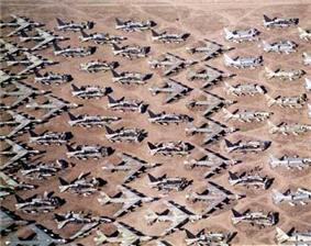 Aerial view of B-52s and other aircraft slowly being scrapped in the desert.