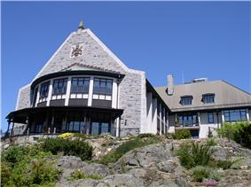 The southeast view of Government House from below, showing the bow window of the Ballroom at left