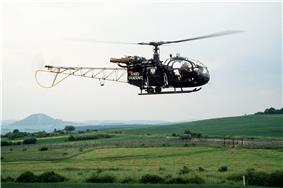 Green-painted helicopter with