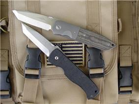 Two similar tanto bladed fighting knives one a custom the other a factory piece.