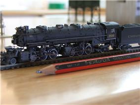 U.S. model of an N scale (1:160) 2-6-6-2 shown with a pencil for size
