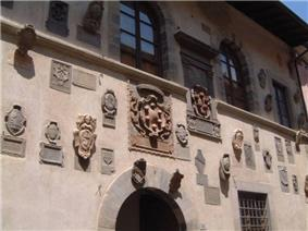 The Medici coat of arms of the façade of the Palazzo dei Capitani.