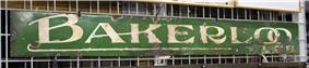 A green metal sign with the words