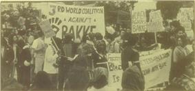a monochrome photo of a protest rally.  Many of the protesters are minorities, and have Afro hairstyles.