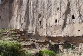 A Remains of multistory dwelling built into volcanic tuff wall. Bandelier National Monument, New Mexico