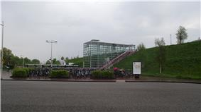 Glass entrance to station with bikes in front