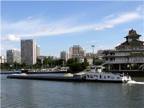 Alfortville and Chinagora, with a barge and tugboat on the River Seine