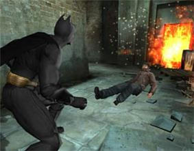 Batman is shown at the left side of the screen, ready to fight. The target is a prone figure on the other side of the screen.