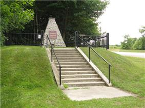 A federal cairn and plaque marks Battle Hill National Historic Site