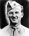 Head of a half-smiling white man wearing a shirt and tie and a garrison cap tilted over his right ear.