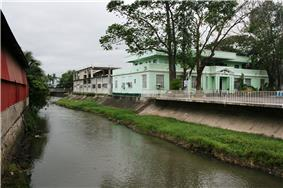 Bay Municipal Hall on the banks of the Bay River