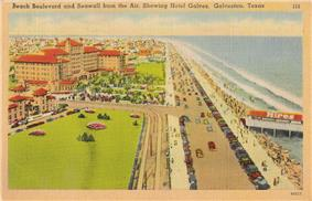 A postcard shows a wide oceanside boulevard lined with cars and pedestrians. A large hotel complex lies on the opposite site from the water, as well as parks and other buildings.