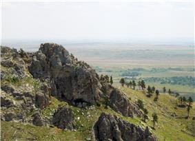 Rocky summit of Bear Butte and view over the Dakota plains.