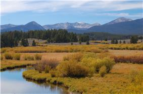 A photo of a stream and mountains in Beaverhead-Deerlodge National Forest.