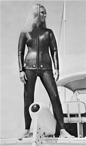 Woman modeling 1960s vintage two-piece wetsuit