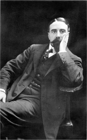 Youngish man, with neat imperial beard and moustache, seated, supporting head with left hand