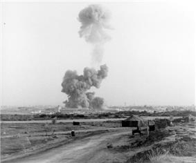 a mushroom cloud rises hundreds of feet from the site of the 1983 Beirut barracks bombing