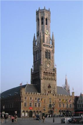 A large tower with a clock near its top.