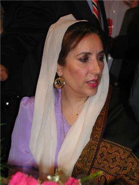 A head and shoulder shoot of a woman in traditional Pakistani dress.