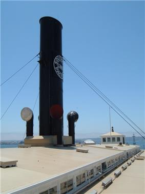 Photograph of the funnel of the ferry Berkeley from the vessel's roof, showing the Southern Pacific logo on the side of the stack.