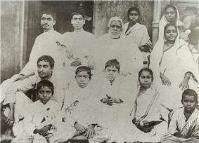 A group photograph of a large Indian family