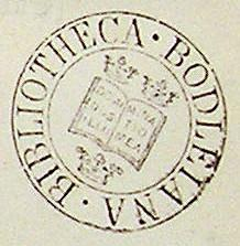 A circular ink stamp mark, with