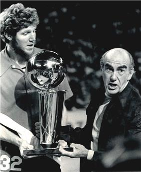 Bill Walton (left) and Jack Ramsay (right) holding the 1977 NBA Championship Trophy.