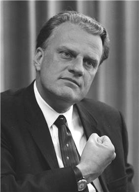 A black-and-white image of Billy Graham