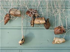 Birch bark fishing net weights.jpg