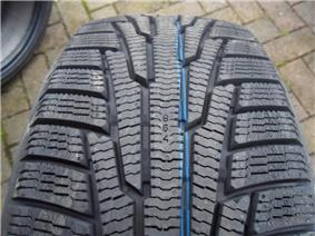 Nokia Hakkapeliitta tread shown with deep treads and many sipes (thin channels) for better winter traction