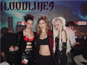 Three young women, dressed as sexy vampires