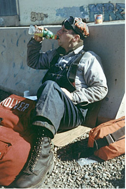 Executive 'Pronto' (Byron Mulver) taking a break during freight hoboing adventure ending 9/11/2001