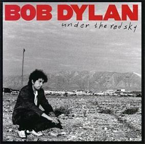 A black-and-white photograph of Dylan sitting in a rocky field