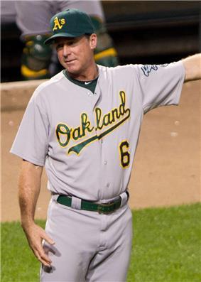 A man wearing a gray baseball uniform with