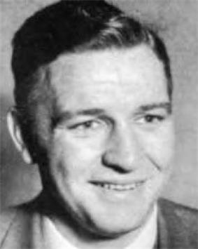 Head shot of Bob Woodruff, white man in his early to mid-30s, shown in a suit jacket and tie
