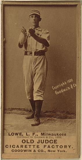 A black and white baseball card featuring a man in a white baseball jersey and striped cap holding both hands out cupped in front of his chest.
