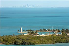 Aerial view of Boca Chita Key with the skyline of Miami in the distance
