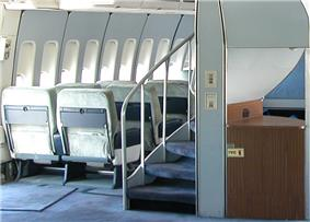 A helical staircase on 747-100s and −200s that leads to the upper deck