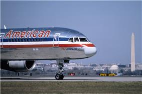 A Boeing 757, registration N64AAA, at Ronald Reagan Washington National Airport in March 1985