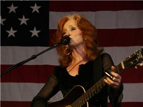 Raitt playing guitar