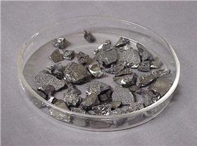 Several dozen small angular stone like shapes, grey with scattered silver flecks and highlights.