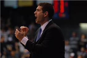 Stevens with his mouth open to shout, and his hands clapping.
